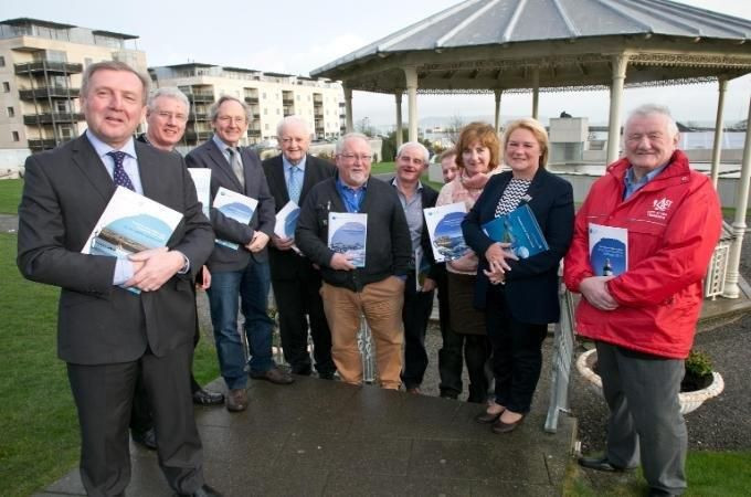 Minister Creed pictured with FLAG Group representatives.